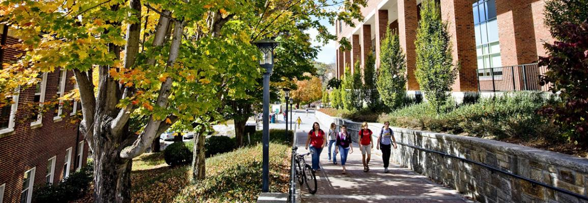 Students walking near library on Appalachian State campus in autumn